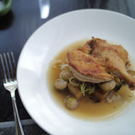 Cripsy Cornish Hen with brussels sprout home fries, lemon-sherry jus