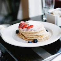 Whole Wheat Pancakes with fresh berries. Photo by Jared Lichtenberger