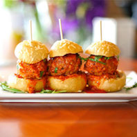 A trio of gravy meatball sliders